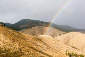 Rainbow Over Mountains Near Doyle, CA